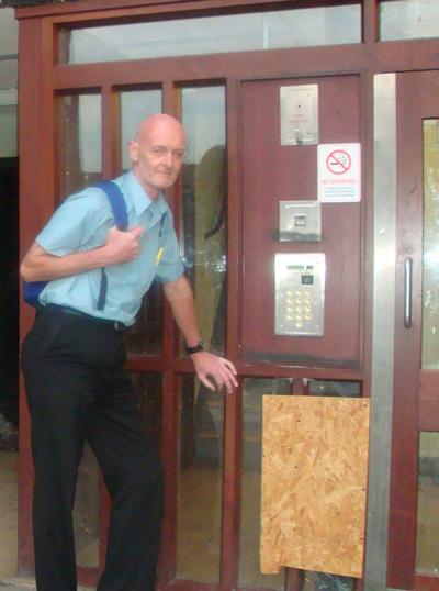 Councillor Haselden by broken window
