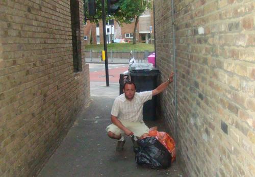 Councillor Wellbelove in alleyway off Queenstown Road