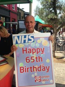 Councillor Wellbelove celebrating 65 years of the NHS at the Venn Street Stall
